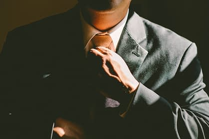 man adjusting tie for interview