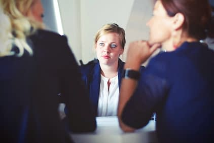 two women conducting an interview with an applicant
